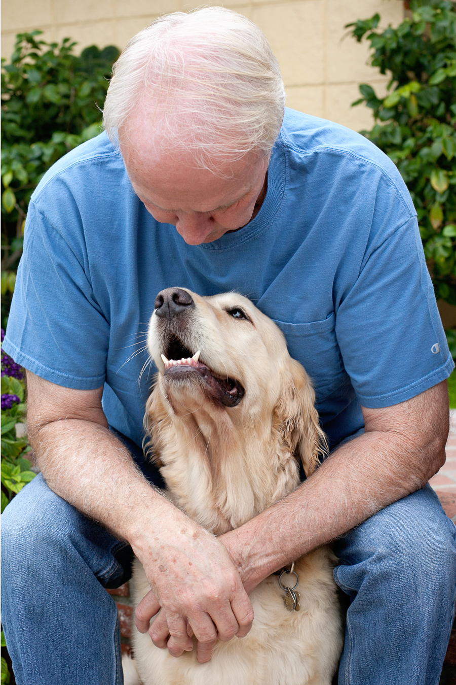 Photo-Man-Golden-Retreiver-With-Dog