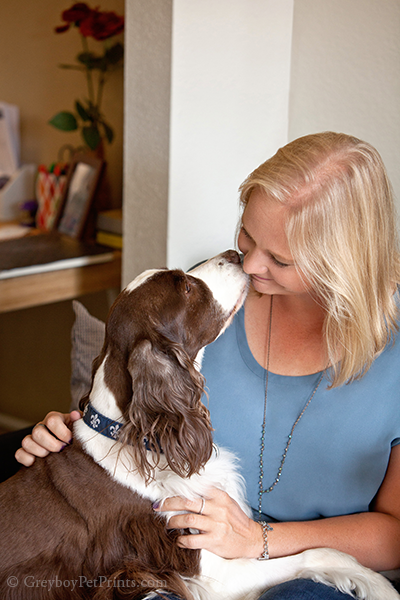 dog portraits at home with dog kissing mom